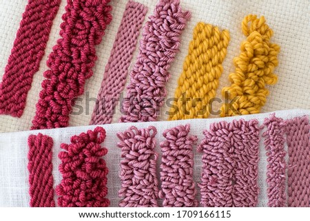 Punch Needle samples of different loops sizes. Different colour wool in various fabrics. DIY concept. Needlework.  Royalty-Free Stock Photo #1709166115