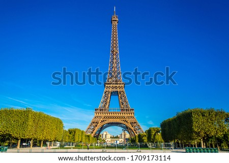 Eiffel tower, famous landmark of the world and popular attraction site. Photo taken from Champ de Mars, Paris, France