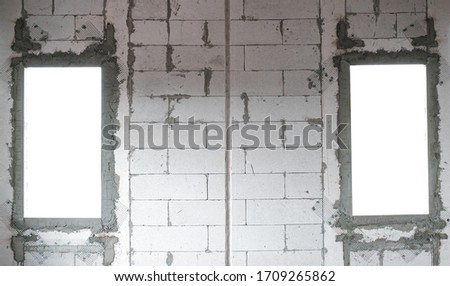 two window for fill advertise business . lightweight cement brick and white lintel plaster to joint for reinforce widow house frame in construction site. #1709265862