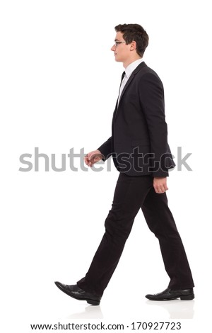 Young elegance man walking. Full length studio shot isolated on white. #170927723
