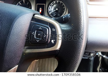gresik - indonesia. April 20, 2020. The panel button adjusts the volume and the CD player channel on the right hand drive of the Toyota car. #1709358106