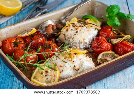 Halibut baked in white wine with borlotti beans and tomatoes