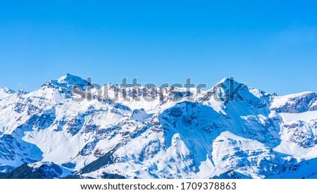 Winter landscape with snow covered peaks on Kleine Scheidegg mountain in Swiss Alps near Grindelwald, Switzerland #1709378863