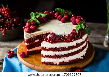 Red velvet cake on wood board. Slice of cake. Raspberry cake. Devil's cake. Wedding dessert. Birthday party. Delicious dessert. Traditional american dessert Royalty-Free Stock Photo #1709379307