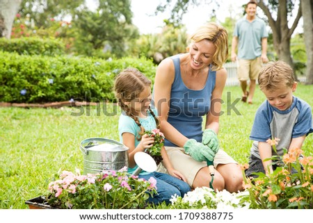 mother and children gardening at home #1709388775