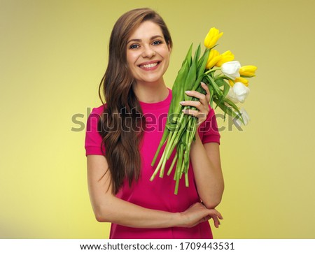 Happy woman in red  holding flowers bouquet. Female person isolated portrait on yellow. #1709443531