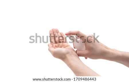 Coronavirus or covid-19 prevention. Hand disinfection with alcohol spray. Man hands using the sanitizer isolated on a white background. Antiseptic and Healthcare concept. #1709486443
