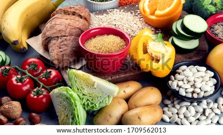 Foods high in carbohydrates on grey background. Vegan Foods high in dietary fiber, antioxidants, vitamins and minerals.  #1709562013