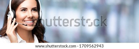 Call Center Service. Looking up customer support or sales agent. Caller or receptionist phone operator. Copy space. Helping, answering, consulting. Over blurred office background. Royalty-Free Stock Photo #1709562943