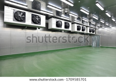 Newly cold storage room with refrigerator machine in the production line at the factory Royalty-Free Stock Photo #1709585701