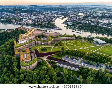 Aerial View of Ehrenbreitstein fortress and Koblenz City in Germany during sunset Royalty-Free Stock Photo #1709598604