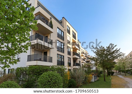 Cityscape of a residential area with modern apartment buildings, new green urban landscape in the city Royalty-Free Stock Photo #1709650513