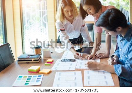 Graphic designers are brainstorming ideas in Choosing color groups to design applications for websites #1709691733