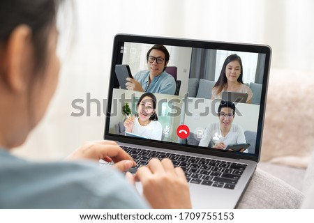 Group of young happy asian work from home meeting or brainstorming online video conference application on 5G internet with covid coronavirus business continuity plan via tablet or notebook computer. #1709755153