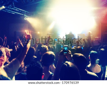 a crowd of people at a concert (focus on the phone photo) #170976539