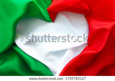 The concept of Italy patriotism - April 25 Liberation Day Text in italian card, italy flag and poppy flowers national public holiday Royalty-Free Stock Photo #1709783527
