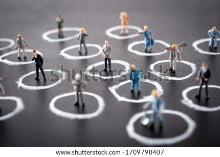 miniature people are standing in their own circle. Separated by default , Social distancing in the workplace during coronavirus (COVID-19) Royalty-Free Stock Photo #1709798407