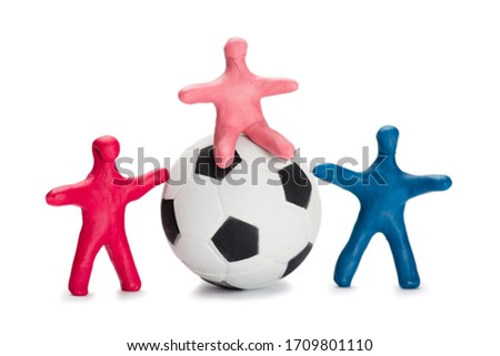 Plasticine small people soccer players with soccer ball isolated on white