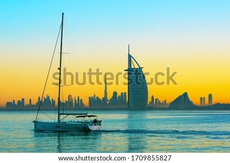 Dubai - amazing city center skyline and famous Jumeirah beach at sunset, United Arab Emirates