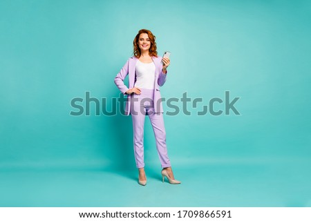 Full length body size view of nice attractive pretty elegant cheerful foxy ginger wavy-haired lady using digital device isolated on bright vivid shine vibrant blue green turquoise color background
