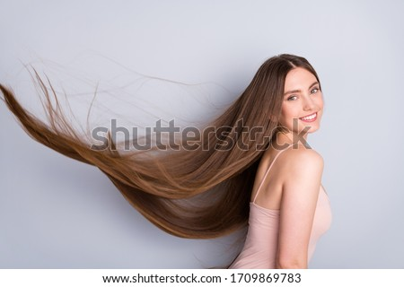 Close-up profile side view portrait of nice-looking attractive lovely gorgeous cheerful well-groomed brown-haired girl wind blowing silky smooth hair isolated on light gray pastel color background Royalty-Free Stock Photo #1709869783