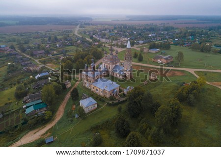 View of the old temple complex in the village of Parskoe on a foggy September morning (aerial photography). Ivanovo region, Russia #1709871037