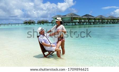 Young couple on a beautiful small island white sand blue sea Maldive Sun Islands.  #1709896621