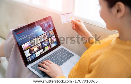 Interface of video distribution service. Subscription service. Streaming video. communication network. #1709918965