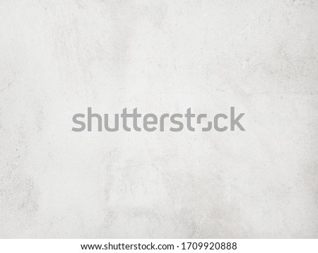 White cement wall background in vintage style for graphic design or wallpaper. Pattern of soft concrete floor in retro concept. #1709920888