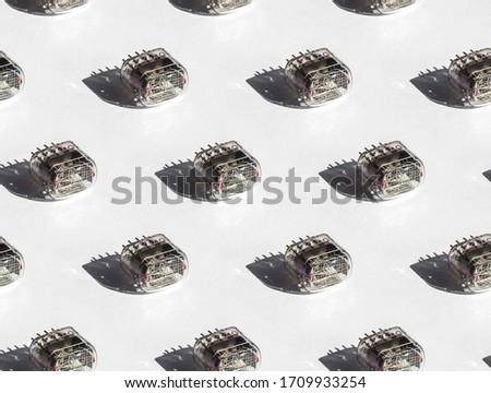 Seamless pattern of nixie tubes IN-12 on a white background, hard light #1709933254