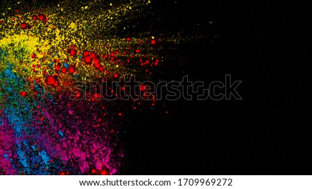 Splashing colours which signify the festival holi in india. It can a editorial background as well a picture in itself,its has vibrant and bright colors.
