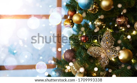 Christmas decorations and toys. New Year atmosphere. Window at Christmas home. Landscape abstract card. Modern blurry postcard. Horizontal bright banner. Nativity snow
