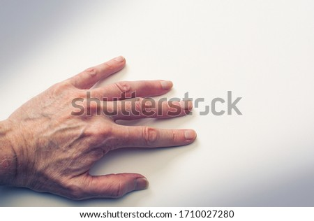 Man's strong hand reaching out to help or in search of help or assistance on white background. #1710027280