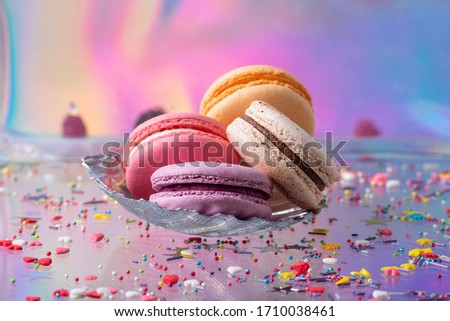 Close up still life with set of four macaroons cookies on colorful gradient background. Sweet dessert concept. Home bakery. French dessert. #1710038461