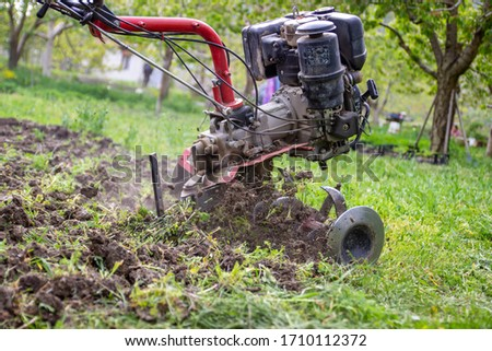 Detail of a cultivator preparing a field to be able to sow it #1710112372