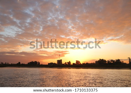 An aesthetic picture at sunset represented in a landscape in the brightest picture amid the beautiful calm waters and under the clear sky in a wonderful atmosphere in Morsi Matrouh, Egypt