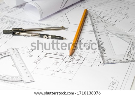 drawing of a part on a table, compasses, protractor, ruler pencil