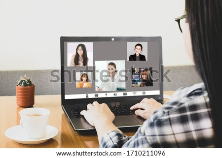 Laptop screen view over shoulder asian woman talking about work,sitting in work desk make video call have distant communication using videoconference app work from home to prevent corona virus #1710211096