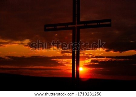 Crucifixion Of Jesus Christ - Cross At Sunset. Black cross religion symbol silhouette. Religious concept