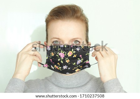 Coronavirus, COVID-19,  2019-nCoV concept. Woman with homemade cotton+microfiber face mask. Woman putting on or taking off face mask.  #1710237508