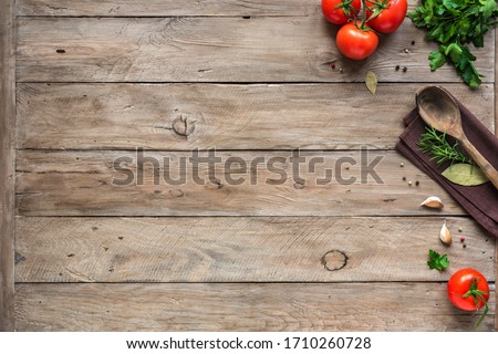 Cooking background, home cooking concept. Ripe tomatoes, spoon, herbs and spices on wooden background, top view, copy space. #1710260728