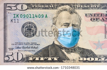Fifty dollar bill with medical face mask on Ulysses S. Grant. #1710348031
