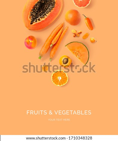 Creative layout made of carrot, papaya, orange, grapefruit, apricot, melon, curcuma, and pepper on the orange background. Flat lay. Food concept. Macro  concept. #1710348328