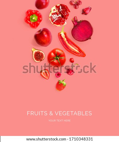 Creative layout made of red apple, red pepper, red grape, beetroot, pomegranate, strawberry, raspberry, cherry, chilli, tomato  on the red background. Flat lay. Macro  concept. #1710348331