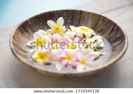 A bowl of flower petals in water #1710349138