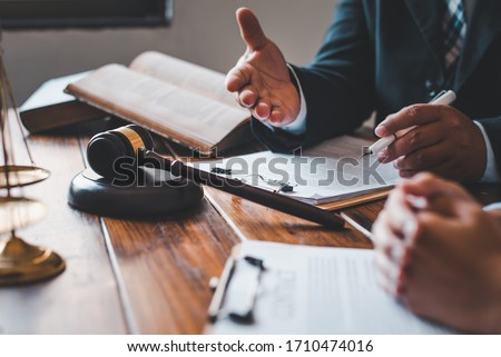 Lawyers give advice about judgment, agreements, justice Customer Royalty-Free Stock Photo #1710474016