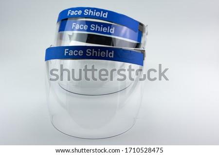 Medical face shield, transparent plastic helmet. Royalty-Free Stock Photo #1710528475