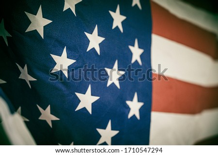 Close up America flag waving with the wind for memorial day. National symbol concept.