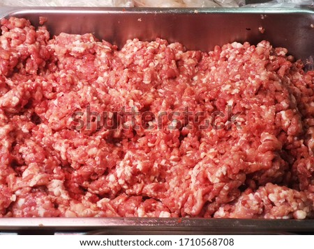 Fresh minced pork for background. A large stack of pork chops from a popular market. raw meat piece of pork or beef close up top view. #1710568708