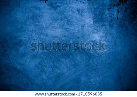 Old wall pattern texture cement blue dark abstract  blue color design are light with black gradient background. Royalty-Free Stock Photo #1710596035